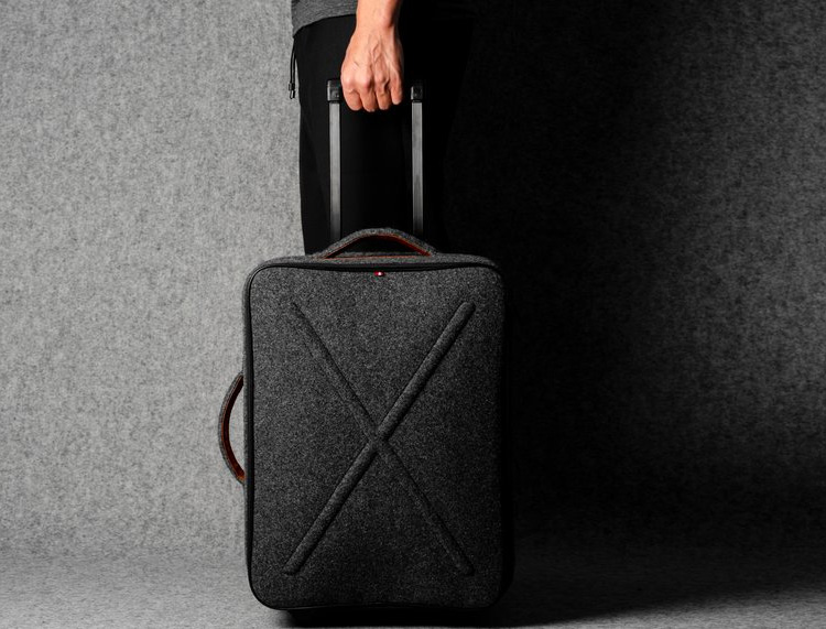 This Rolling Carry-On Looks Luxe In Italian Wool at werd.com